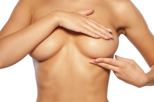 woman feeling breast implants