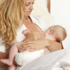 woman breast feeding with implants