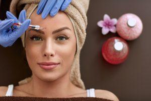 woman receiving facial injection dermal filler botox